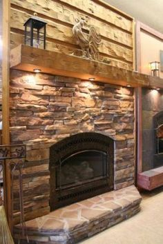 fireplace remodel idea ~ rustic mantle, stone everywhere else. Perfection.- love the lights underneath