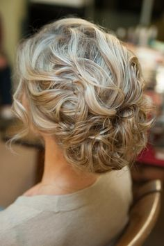 Soft curls with face-framing pieces. Hair doesn't look overly sprayed.