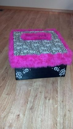 A card box made for a zebra and pink themed graduation party: a hat box covered in zebra and black duct tape with a boa type trim!