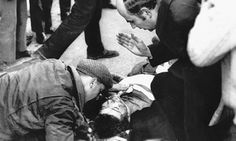 A priest gives last rites to a boy injured on Bloody Sunday