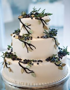 blueberries with branches! I love this, it has a cool vintage feel to it. Perfect for winter wedding!