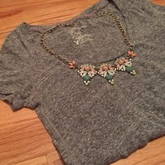 Grey Scoop Neck Tee Marled grey scoop neck tee from American Eagle Outfitters. Has some wear, but no holes or damaging to the stitches. A classy but simple top, good for pairing with jeans or leggings. American Eagle Outfitters Tops Tees - Short Sleeve