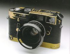Legend Elliott Erwitt's Leica M4 with Leicavit winder. Beautiful brassing from years of love and work. -repinned by LA County portrait studio http://LinneaLenkus.com #portraitphotography
