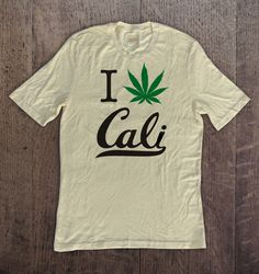 Spring Sale! 15% OFF on all All Hemp Apparel. Sale goes until 4/20/16 Type 'zenhemp' when you checkout. Free Shipping $50+ Hemp Graphic Short Sleeve Natural Color T-Shirt. I weed Cali on 60%Hemp and 40% tencel tee.