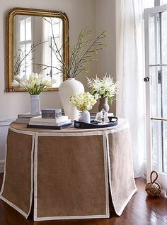 The white grosgrain trim on this paneled table skirt is so sophisticated.
