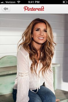 Golden blonde, rich highlights on natural brunette. I want that length (and that face would be nice too) ;)