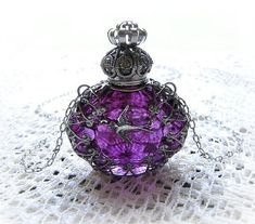 Glass Perfume Bottle Necklace by charity.  My favorite bottle  <3  ~ S.