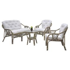 Refresh your sunroom or three-season porch with this wicker seating group set, showcasing a glass-topped table, cushioned sofa, and 2 arm chairs.   ...