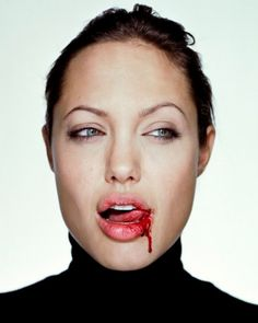 Angelina Jolie. Ugh. Is she a vampire. Great my daughter will really love her more now. The blonde in the pic.