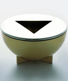 Marianne Brandt Ashtray  Marianne Brandt Designed 1924  Produced by Tecnolumen  Brass with nickel-plated brass removable lid  H. 2¼ in. D. 4⅜ in.