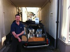 Our Tom staying out of the sunshine beside the store. Perhaps an iced coffee would have been in order!