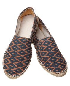 Take a stylish approach to dressing in warmer climates with these canvas espadrilles.