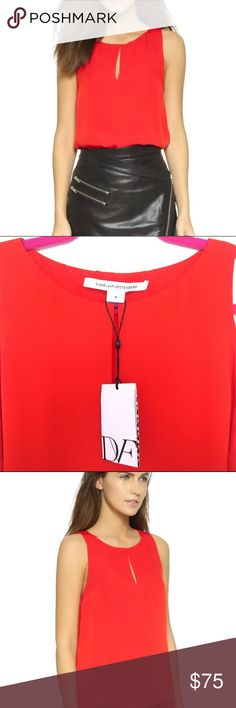 Diane Von Furstenberg Top My favorite DVF Raica Top. Sold out everywhere! Classy and simple blouse cut from delicate silk! It will fit both Small and Medium since its a loose top! Diane Von Furstenberg Tops