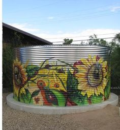 Corrugated Galvanized Steel Cisterns; paint it to lessen the visual impact of the large structure.