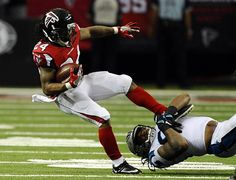 Carolina Panthers outside linebacker Shaq Thompson (54) brings down Atlanta Falcons running back Devonta Freeman (24) during the second half at the Georgia Dome in Atlanta, Ga. on Sunday, October 2, 2016. Atlanta won 48-33.