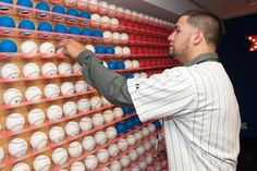 Hector Santiago #53 of the Chicago White Sox signs the Rawlings Ball Wall during a visit to the MLB Fan Cave Wednesday, September 4, 2013, at Broadway and 4th Street in New York City. (Photo by Thomas Levinson/MLB Photos via Getty Images)