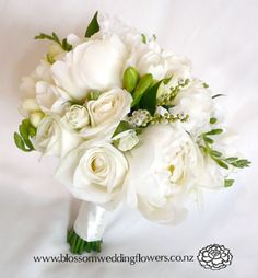 white peonies, roses, freesia, lily of the valley , and sweet pea, bound in ivory satin and pinned with pearls