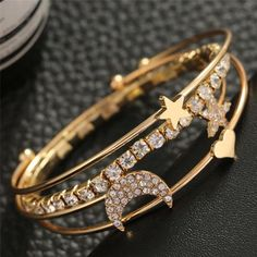 Product Information Product Type: 4 Bracelet Set Size: Adjustable Color Options: Gold, Silver Stylish Jewelry, Cute Jewelry, Luxury Jewelry, Women Jewelry, Fashion Jewelry, Bangle Bracelets, Bangles, Bracelet Set, Vampire Diaries Jewelry