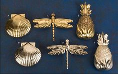 These beautiful door knockers are made of sand-cast brass. Polished brass (PB) or satin nickel (SN) finish. Each knocker is attached to a solid brass mounting plate with a stainless-steel screw. Gift box and mounting screws included.  A & B. Bay Scallop Knockers Designed to complement a maritime cottage theme, this knocker is 3-3/4 long by 3-7/8 wide and projects 1-5/8.  C & D. Dragonfly Knockers This solid brass knocker resembles a dragonfly poised on your door. It is 4-1/2 long with a…