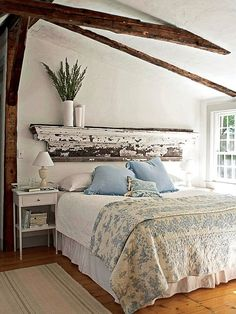 Love the rustic shelf headboard!