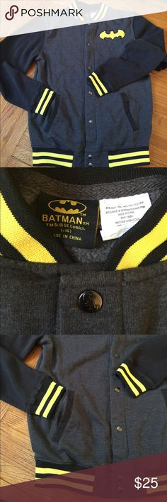 Men's D.C. COMICS BatMan sweater jacket. Size 14 Men's D.C. COMICS Bat Man sweater jacket. Size 14 looks to be a large. Black sleeves with yellow and black striped wrists, collar and bottom trim. Also has embroidered Bat Man logo on left chest. Cool 😎 the buttons are grey metal with the Bat Man logo on them as well. Nice sweater jacket that buttons up. DC COMICS Jackets & Coats Bomber & Varsity