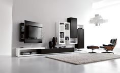 SIDE SYSTEM 25 - Modern living area, black and white with functional suspended library and Tv panel.  http://www.fimarmobili.com