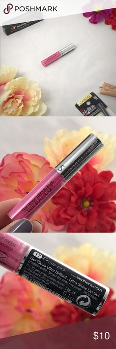 Sephora Ultra Shine Lip Gel Ultra shine gives is a gel formula. Causing your lips to look plump and very glossy. Ultra light & very hydrating.   . ▪️color: Pin-Up Pink ▫️high shine finish  ▪️net wt. 0.1 *note- this is the travel size* ▫️new - sealed Sephora Makeup Lip Balm & Gloss