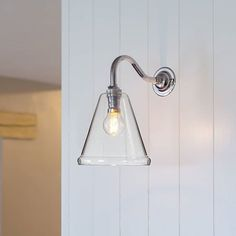 Our Rye clear glass Cone Glass wall light with swan fitting is a unique and bespoke British made handblown glass shaded wall light. This wall light offers a wholly unique shape of shade - one that is the perfect mixture of elegance and simplicity.