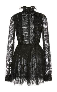 Rendered in partially sheer lace, this **Elie Saab** Jumpsuit features a high frill collar and macramé chest panel.