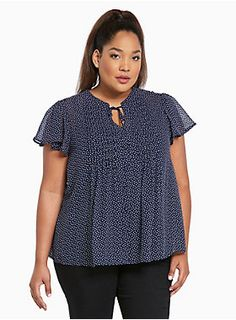 We knew you'd love this top. The sheer navy chiffon will have your admirers…