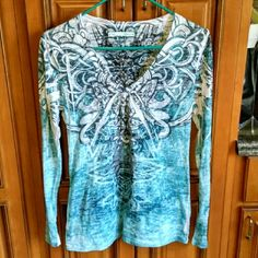 Maurices tattoo style long sleeve shirt size large Great top! No piling. Thin fabric, almost burn out looking, but not quite as sheer. 50% cotton, 50% polyester. Size large. Second pic is the front, third pic is the back. Any questions, just ask! Maurices Tops Tees - Long Sleeve