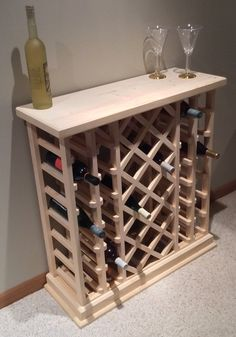 """This wine rack measures 33 1/2"""" long, 35"""" high and 12 1/4"""" deep. $165.00. I find it fair to quote shipping cost based on destination. Please send me your zip code and I will be happy to send you the shipping fee. The wine rack can be left natural, stained, or clear coated. Our wine racks are made per order using quality pine. Assembly is easy requiring a screw driver. Instructions are included. Cheers! Dan"""