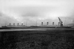 Olympic (right) along side Titanic (left) in Belfast in March of 1912. Titanic was being fitted out, while Olympic was getting a propeller repaired. It is only one month away from Titanic's maiden voyage.