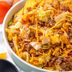 The perfect Taco Salad for a potluck or party! This Doritos Taco Salad is always a hit anywhere I bring it and we've been serving it my entire life. It's loaded with ground beef, cheese, lettuce, tomatoes, onions and Nacho Cheese Doritos for the perfect crunch! #dorito #salad #taco #tacosalad #potluck #recipe #recipeidea #julieseatsandtreats