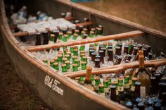 AK Brides - Wedding Planning Services - A row boat holds ice cold beer and wine for this beach wedding.  Jerrod Brown Studios Birmingham AL
