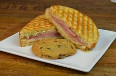 Our NEW Ham Apple Brie Panini - a sweet and savory comfort made with honey cured ham, tart apple, creamy brie and honey mustard grilled on rustic cracked wheat. #fall #woodycreekcafe