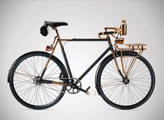 luxury sports equipment brand williamson goods collaborates with another local, the detroit bicycle company, in creating a copper-plated, python-skin wrapped, handmade bicycle.