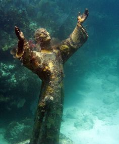 """The original """"Il Christo Degli Abissi"""" statue was placed in the Mediterranean Sea off Genoa, Italy, in 1954. In 1961, a second statue """"Christ of the Deep"""" was cast from the same mold. The Cressi family of Italy donated the statue to the Underwater Society of America, which in turn donated it to the Florida State Park Service, in recognition of the conservation efforts involved in the creation of America's first underwater park...     By mcdermitt08"""