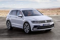 The Volkswagen Tiguan is one of the brand's best-selling models, but the new version, which debuted at the 2015 Frankfurt Motor Show, has been eagerly awaited. It's set to go on sale in 2016, with trim levels including the sporty R-Line and potentially a hybrid GTE version. The new Tiguan features an updated design and is bigger, longer, and lower than the outgoing model.