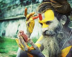 Sadhu applying his tilaka at Pashupatinath temple in Kathmandu. Pashupatinath is the holiest hindu site in Nepal.