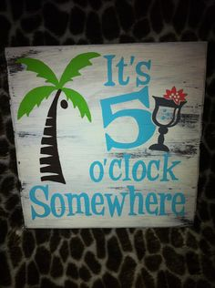 """""""It's 5 o'clock Somewhere"""" wooden sign."""