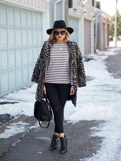 Black skinny jeans, striped tee, black ankle boots, leopard coat