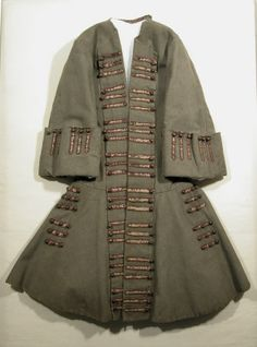 Coat National Trust Inventory Number 1348787 Date1720 - 1729 MaterialsBrass, Hessian, Silk velvet, Wool CollectionSnowshill Wade Costume Collection, Gloucestershire (Accredited Museum)