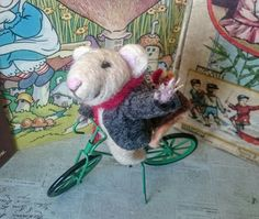 Picking up chicks. Needle felted Mouse on metal bike with a couple of needle felted chickens. Mr. mouse is sporting a Grey wool fitted jacket from the Jos A. Cheese collection and a lovely red wool scarf by Thomas Mouserton (famous Mouse accessory designer...trust me) Fun and whimsical piece. Made from wool roving over wire armature. Measures 5.5 inches across and approx 4 inches tall. One full piece with no removable parts. Not intended for children.