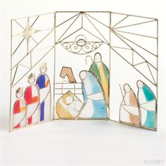 Stand this wonderful triptych nativity on a mantle or window sill! The hand-painted capiz shell looks like stained glass. The wire frame fol...