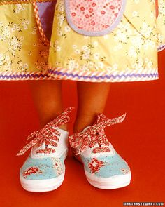 Fabric-Covered Sneakers - I love these fabric covered sneakers.  Dress up little tootsies with an inexpensive pair of shoes, some glue, a few bits of fabric, and your imagination. In no time, ordinary shoes can become enchanted.
