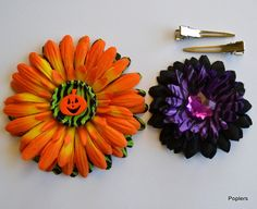 okay how cute are these? flowers that you can pull apart and remake and build to fit your need. magnets make customizable looks easy and affordable. www.poplers.com my new obsession. and now i have a flower for each picture/outfit!!