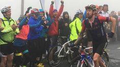 Bradley Wiggins jokingly runs up the Struggle climb at the Tour of Britain