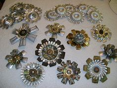 Tin Flowers using jello molds tarts etc..just cut with tin snips and drill if needed. ( no tutorial just picture )