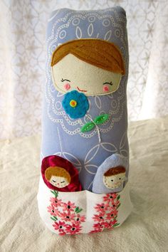 Mama Matryoshka stops and smells the flowers...with babies in tow, of course!